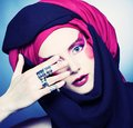 Young woman with creative make up in black and red turban Stock Photos