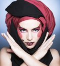 Young woman with creative make up in black and red turban Royalty Free Stock Images