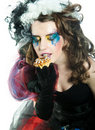 Young woman with creative make-up with cake. Stock Photo
