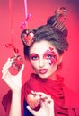 Young woman with creative make up red and pink hearts Royalty Free Stock Photos