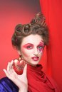Young woman with creative make up red and pink hearts Stock Photography