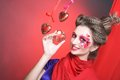 Young woman with creative make up red and pink hearts Stock Images