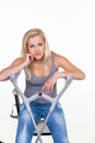 A young woman with crutches symbolic photo for accidents domestic accidents and insurance Stock Photo