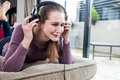 Young woman crying in removing her headphones for noisy music Royalty Free Stock Photo