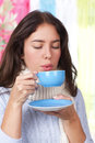 Young woman with a cup of hot tea and knitted scarf Stock Image