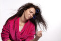 Young woman with curlers in bathrobe messy hair and Stock Image