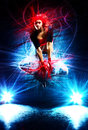 Young woman dancer jumping with special light effects Stock Photo