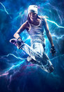 Young woman dancer jumping with special lightning effect Royalty Free Stock Image