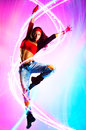 Young woman dancer modern dance with light effects Stock Photos
