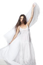 Young woman dancing in gorgeous white dress over Royalty Free Stock Photo