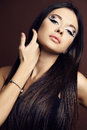 Young woman with dark hair and bright extraordinary makeup fashion studio portrait of beautiful Royalty Free Stock Photos