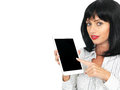 Young woman with dark holding and using a computer tablet attractive short black or hair in the style of bob in her twenties Royalty Free Stock Photo