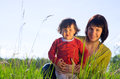 Young woman with daughter women small outdoor on sunny day Stock Photography