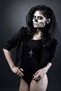 Young woman in day of the dead mask skull halloween face art with fog on black background Stock Photo