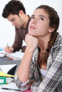 Young woman daydreaming in class women a Royalty Free Stock Image