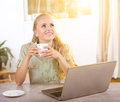 Young woman daydreaming in office Royalty Free Stock Photo