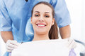 Young woman at dentist office smiling Royalty Free Stock Image