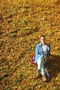Young woman in depression outdoor autumn park thoughtful pensive sad unhappy girl thinking the loneliness stress Royalty Free Stock Image