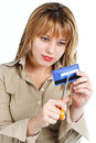 Young woman destroying credit card Stock Photos