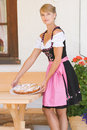 Young woman in dirndl with cake Royalty Free Stock Photos