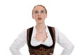 Young woman in a dirndl looks up isolated on white Royalty Free Stock Photo