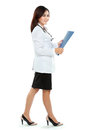 Young woman doctor in lab coat holding clipboard isolated over white background Stock Images
