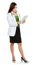 Young woman doctor using tablet computer isolated over white background Stock Photo