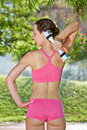 Young woman does dumbbell exercises in morning garden back view Royalty Free Stock Photos