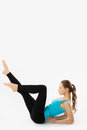 Young woman does fitness exercise on a white background Stock Photos