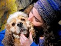 Young woman and dog in love with her Royalty Free Stock Image