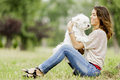 Young woman with a dog maltese Royalty Free Stock Images