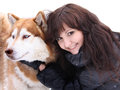Young woman and dog siberian husky dogs on snow winter Royalty Free Stock Image