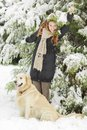 Young woman with dog at winter in forest Stock Images