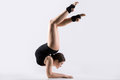 Young woman doing acrobatic handstand exercise Royalty Free Stock Photo