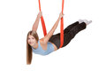 Young woman doing anti gravity aerial yoga in red hammock on a seamless white background Stock Photography