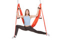 Young woman doing anti gravity aerial yoga in upside down hammock on a seamless white background Royalty Free Stock Photos