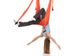 Young woman doing anti gravity aerial yoga in upside down hammock on a seamless white background Stock Photo