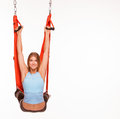Young woman doing anti-gravity aerial yoga in