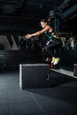 Young woman doing a box jump exercise. Royalty Free Stock Photo