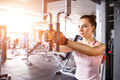 Young woman doing butterfly exercise in the gym Royalty Free Stock Photo