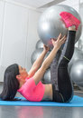 Young woman doing crunches  the gym Royalty Free Stock Photo