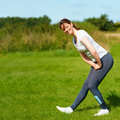 Young woman doing exercise outdoors Stock Photos