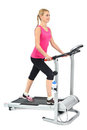 Young woman doing exercises on treadmill Stock Photography