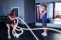 Young woman doing functional training women with ropes at the gym Royalty Free Stock Images