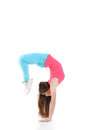 Young woman doing gymnastic exercises fitness stretching with a flexibility exercise isolated on a white background Royalty Free Stock Photos