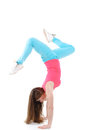 Young woman doing gymnastic exercises fitness stretching with a flexibility exercise isolated on a white background Royalty Free Stock Images