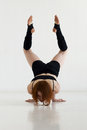 Young woman doing gymnastics or callisthenics Royalty Free Stock Photo