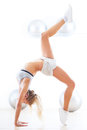 Young woman doing gymnastics working out at a health club Royalty Free Stock Photo