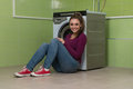 Young woman doing housework laundry pretty smiling girl in the room Stock Images