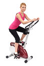 Young woman doing indoor biking exercise on white background Royalty Free Stock Photo